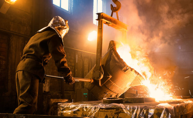A Foundry Worker Pouring Liquid Metal